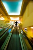 Man on moving staircase — Stock Photo