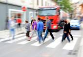 Busy city street people on zebra crossing — Stock Photo
