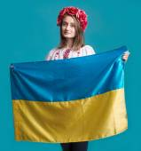 Portrait of attractive young  girl in national dress with  Ukrai — Stock Photo