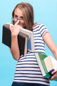Attractive student girl in glasses with books — Foto Stock