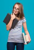 Attractive student girl in glasses with books — Stock Photo