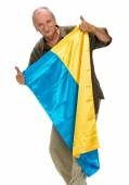 Elderly man with Ukrainian flag in his hands  showing thumbs up — Stock Photo