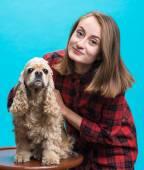 Pretty smiling girl with american spaniel  — Stockfoto