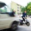 Постер, плакат: Dangerous city traffic situation with a motorcyclist and a bus