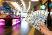 Man holding stack of dollar bills — Stock Photo
