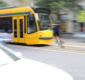 Dangerous city traffic situation with cyclist and tram — Stock Photo