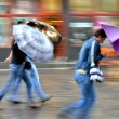 People walking down the street on a rainy day — Stock Photo #54237451