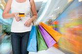 Woman holding shopping bags and credit card  — Foto de Stock