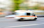 Ambulance in motion driving down the road — Stock Photo