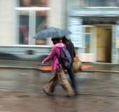 People walking down the street on rainy day — Stock Photo