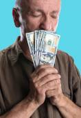Lucky elderly man holding dollar bills — Stock Photo