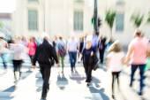 Busy city street people on zebra crossing — Stock Photo
