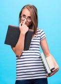 Attractive student girl in glasses with books — Foto de Stock