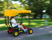 Girls racing in a pedal cart — Stock Photo