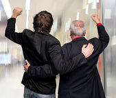 Back view of two winning businessmen — Stock Photo