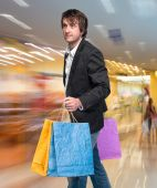 Handsome young man with shopping bags — Foto de Stock