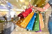 Female holding shopping bags — Stock Photo
