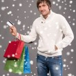 Man holding shopping bags and credit card — Stock Photo #58115647