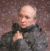 Portrait of a senior man in winter clothing — Stock Photo