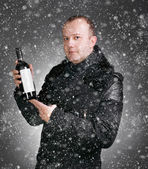 Man with bottle of wine — Stock Photo
