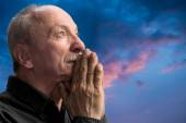 Senior man praying — Stock Photo