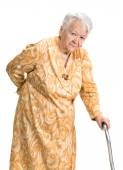 Old woman suffering from low back pain — Stock Photo