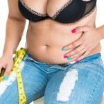 Plump woman pinching her fat tummy — Stock Photo #61857767