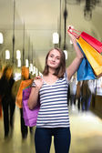 Young teen girl with shopping bags — Stock Photo