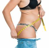 Overweight woman measuring her body — Stock Photo