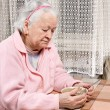 Old woman eating at home — Stock Photo #62153865