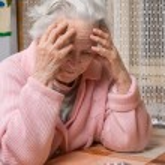 Old sad woman holding pills — Stock Photo #62153909
