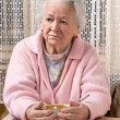 Old woman eating at home — Stock Photo #62153987