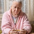 Old woman eating at home — Stock Photo #62153995