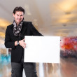 Smiling handsome man with big blank board — Stock Photo #63800443