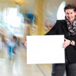 Smiling handsome man with big blank board — Stock Photo #64502113
