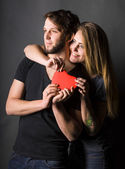Happy couple with red heart  — Stock Photo