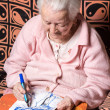 Old woman painting for fun — Stock Photo #68064935