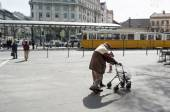 Old man using walking aid  — Stock Photo