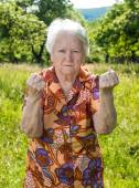 Old woman in angry gesture — Stock Photo