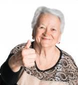 歳の女性示す ok の標識 — ストック写真
