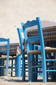 Traditional blue greek chairs in a taverna — Stock Photo
