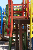 Traditional wooden multicolored chairs in Crete. Greece — Stock Photo