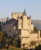Castle and trees at sunset in Segovia. Alcazar.  — Stok fotoğraf
