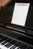 Chopin classical musical score with piano and background — Stockfoto