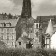 St. Johns church tower and antique buildings. Edinburgh. UK — Stock Photo #63573311