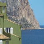 Mediterranean coastline landscape with green building in Spain. — Stock Photo #66956593