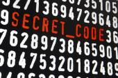 Computer screen with secret code text on black background — Stock Photo
