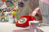Vintage red telephone in a teen ager girl room — Stock Photo