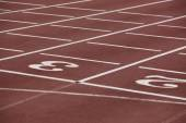 Numbers two and three signpost in a athletic running track — Stok fotoğraf