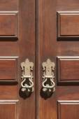 Antique entrance wooden classic doors with metallic locks — Stock Photo